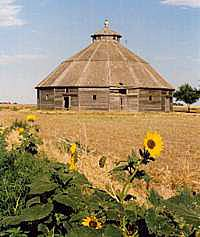 An old wooden barn with a rounded roof