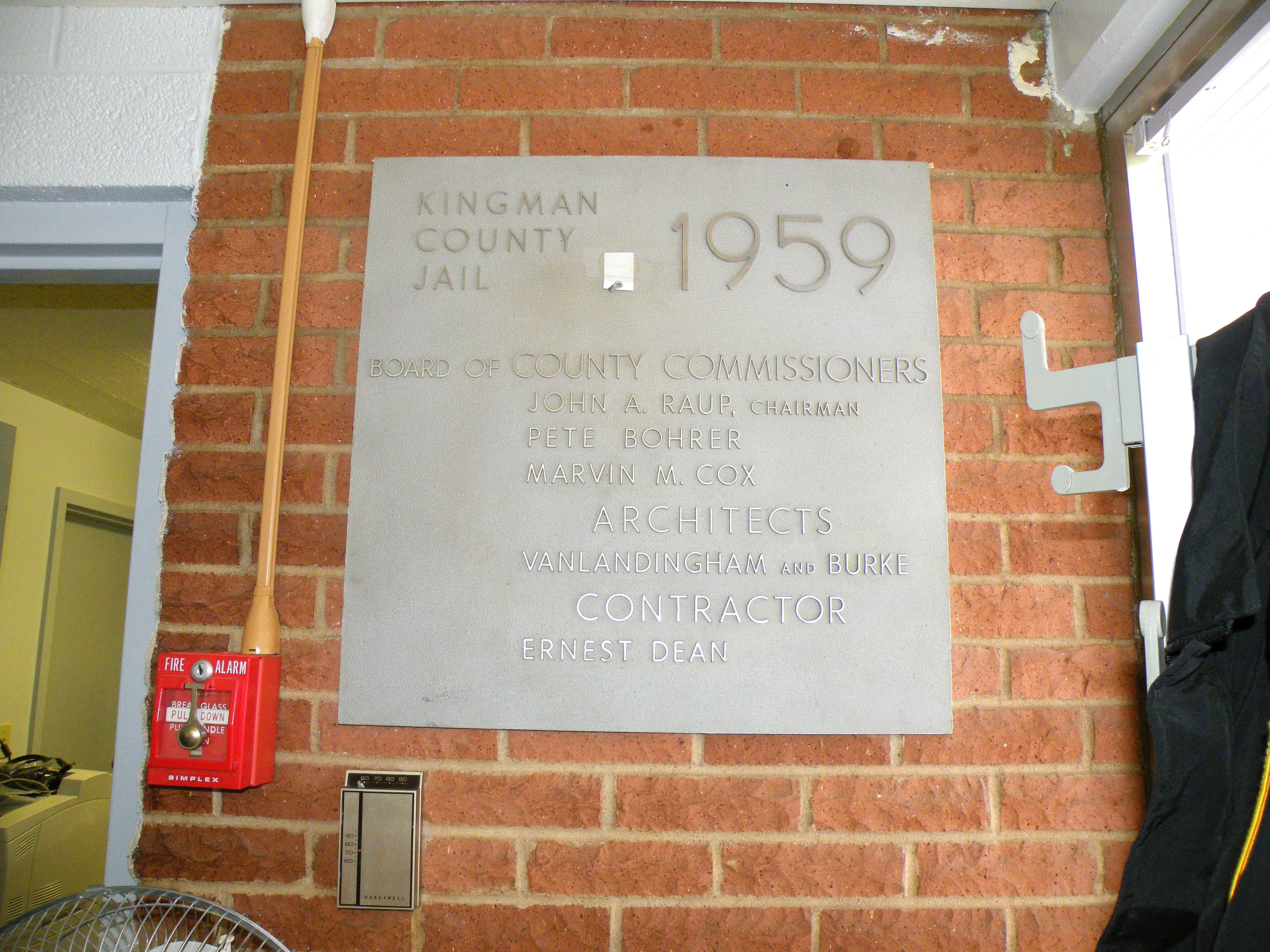 A large plaque on a brick wall